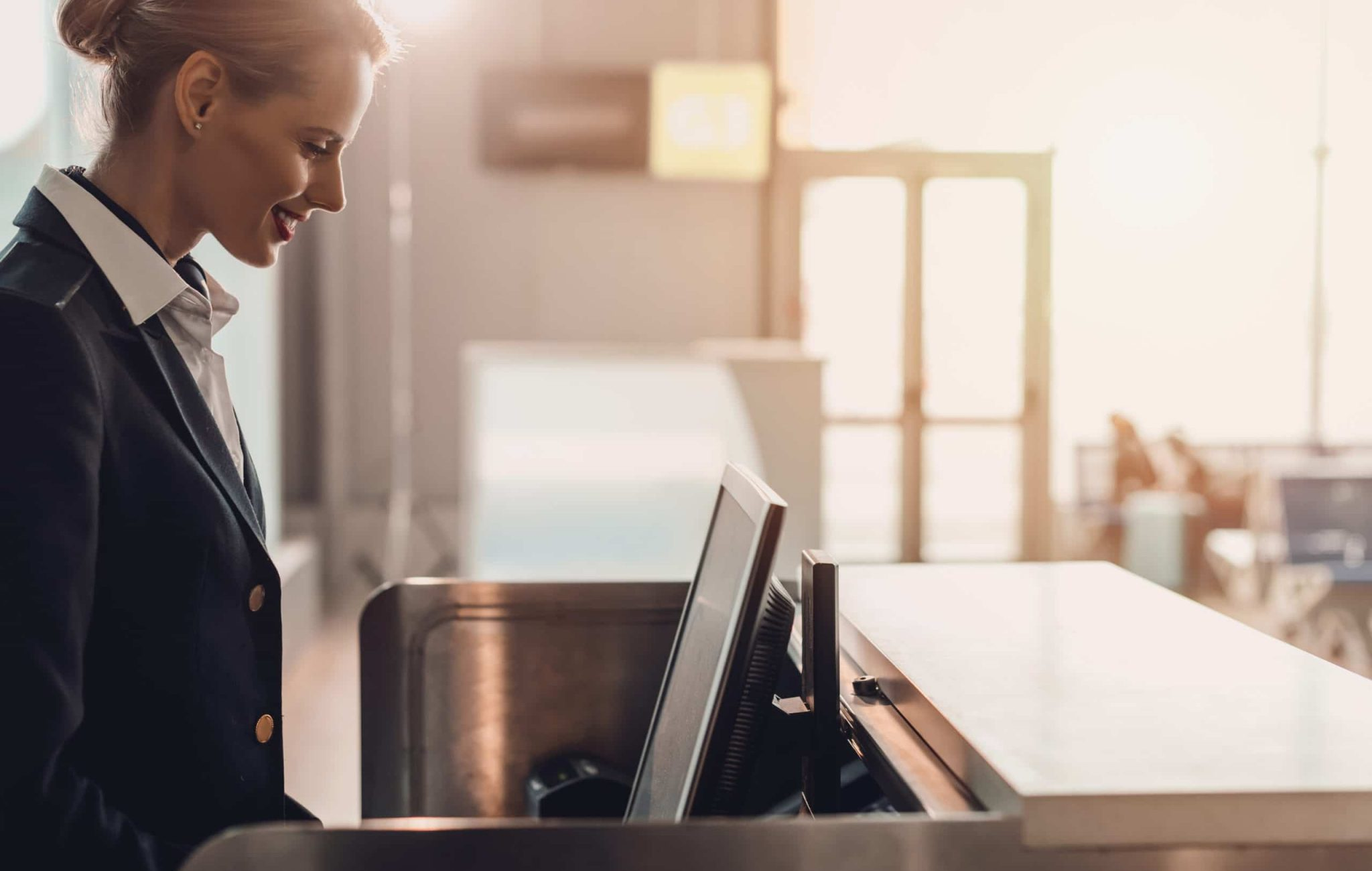 Side,View,Of,Attractive,Young,Airport,Worker,At,Workplace,At